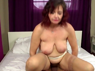 Uncompromised mature mom takes young cock procure hairy vagina