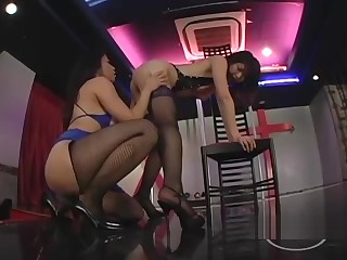 2 Asian Strippers Patting Sucking Nipples On The Stage Connected with The Floor show
