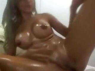 Oiled up girlfriend having fun with dildo first of all webcam
