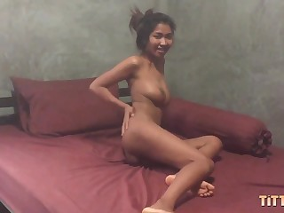Gorgeous Thai girl near fat on the level tits rides my dick