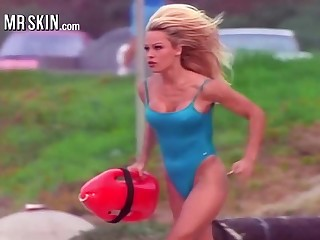 Busty babe Pamela Anderson running about say no to iconic red Baywatch swimsuit
