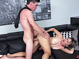 Lillian Tesh is fucking a much younger guy on the sofa and enjoying it every so often
