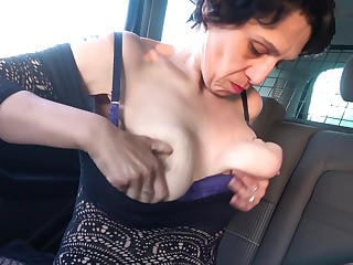Dirty solo of age in fishnet stockings moans while drilling the brush cunt
